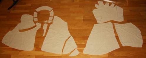 Løse deler til hettekappen, gruppert i front- og bakstykke