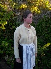 Forkleet hører med til hverdagsantrekket / The apron was an importent part of the everyday outfit