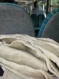 Søm på bussen. Da gjelder det å ha brettet kjolen godt sammen, slik at det blir plass til medpassasjerer / Stitching on the bus, trying not to put the needle in any of the other passengers