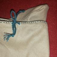 Snøringen og en rad med prikksøm / The draw string and a row of decorative stitches