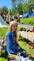 Oline i helt nylaget vikingkjole, hun skullle passe markedsboden på lørdagen / Oline in her new dress. She was in charge of sales Saturday