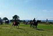 Oppvisning i tentpegging, en fartfylt rideøvelse / Riders demonstrating the sport tent pegging