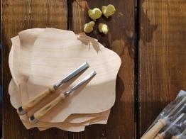 Klar til å lage lissehull i en stabel med hudsko / Ready to make a lot of holes in a stack of Iron Age shoes